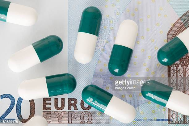 Capsules on a euro note