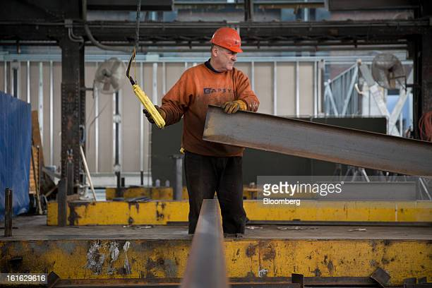 A Capsys Corp employee moves a steel wbeam for a modular housing unit at the Brooklyn Navy Yard in the Brooklyn borough of New York US on Wednesday...