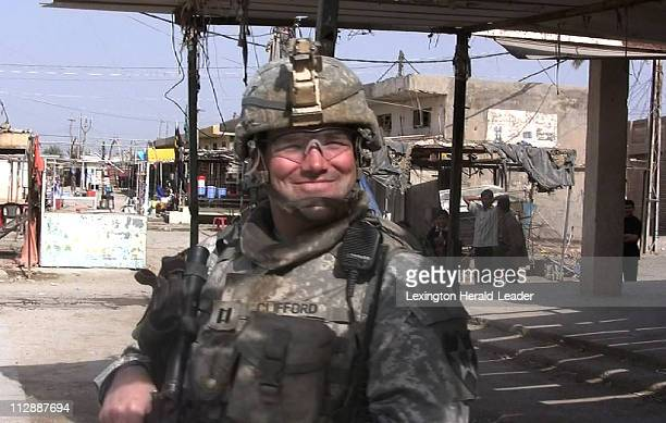 Capt Adam Clifford of Fresno California pauses on a street corner while patrolling in a Khan Bani Sa'ad Iraq neighborhoond on March 2 2008