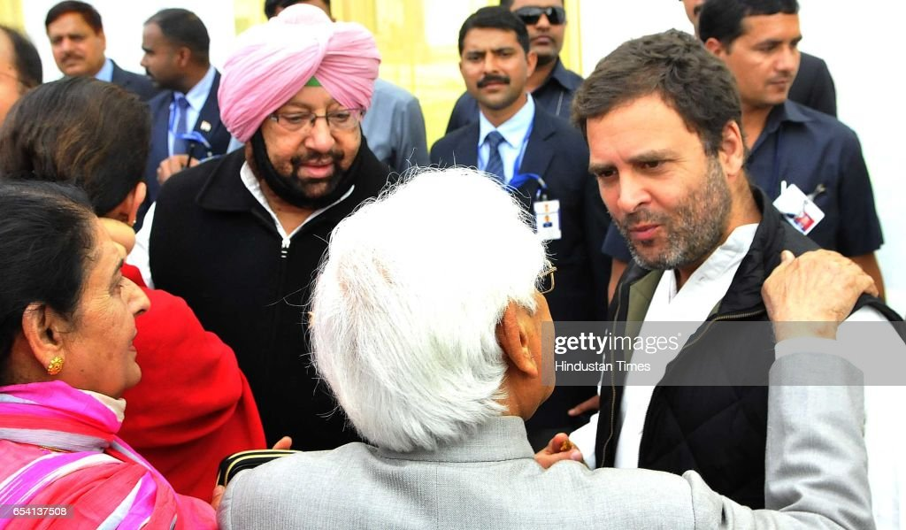 Capt Amrinder Singh and congress party vicepresident Rahul Gandhi interacting with Natwar Singh after oath ceremony at Punjab Raj Bhawan on March 16..