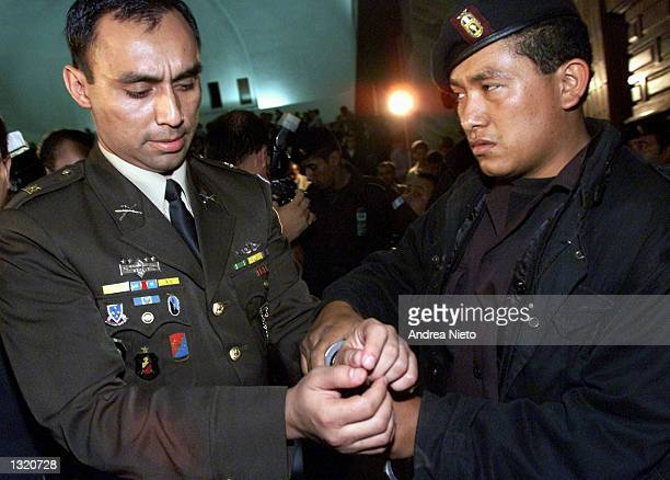 Capt Byron Lima Oliva left is handcuffed as he leaves Guatemala''s supreme court June 8 2001 in Guatemala City after being sentenced to 30 years in...
