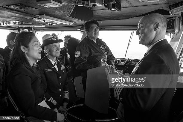 Capt Christopher Bolt right commanding officer of the US Navy's only forwarddeployed aircraft carrier USS Ronald Reagan CVN 76 explains flight deck...