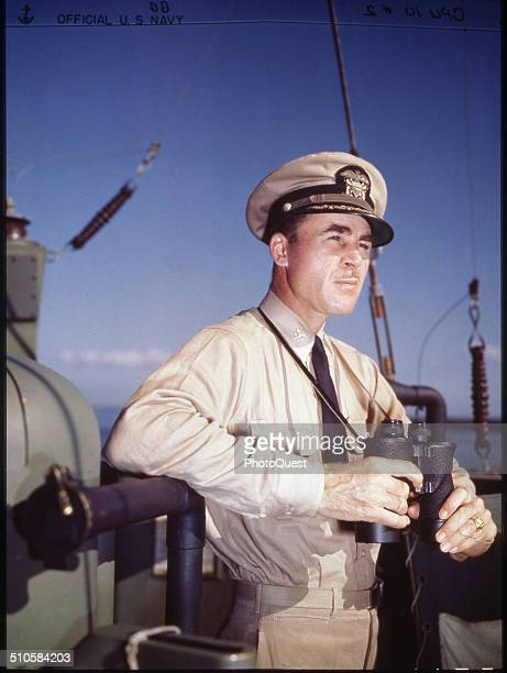 Capt Theodore Aylward USN acting commodore of Gunboat Support Group Task Force 52 on the bridge of his flagship USS LCFF988 during amphibious...