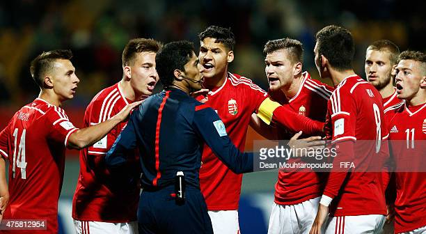 Captain Akos Kecskes of Hungary leads the appeals to the referee Fahad Al Mirdasi after he awards a penalty against his team in the final minutes of...