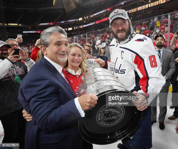 Captain Alex Ovechkin of the Washington Capitals and team owner Ted Leonsis hold the Stanley Cup after Game Five of the 2018 NHL Stanley Cup Final...