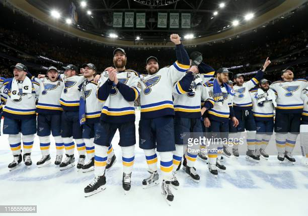 Captain Alex Pietrangelo and David Perron of the St Louis Blues celebrate with their teammates after the 2019 NHL Stanley Cup Final at TD Garden on...