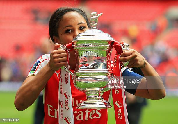 Captain Alex Scott of Arsenal kisses the trophy after the SSE Women's FA Cup Final between Arsenal Ladies and Chelsea Ladies at Wembley Stadium on...