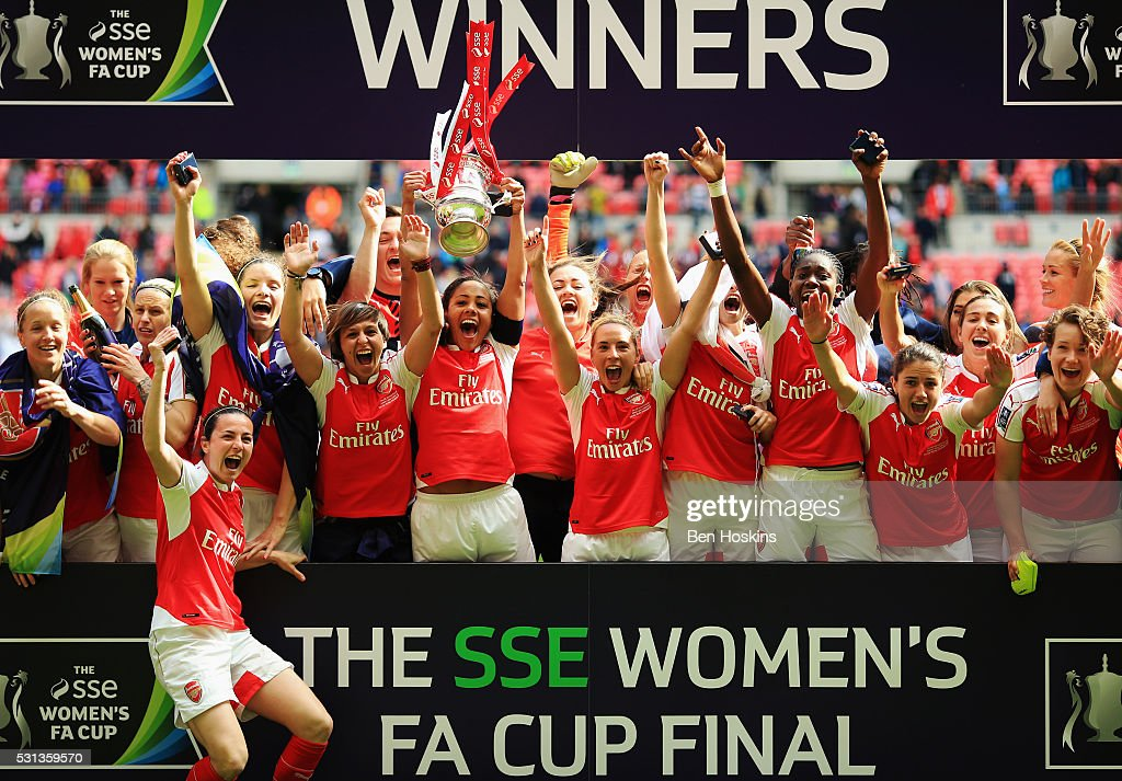 Captain Alex Scott of Arsenal lifts the trophy as they celebrate victory after the SSE Women's FA Cup Final between Arsenal Ladies and Chelsea Ladies at Wembley Stadium on May 14, 2016 in London, England.