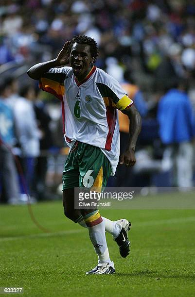 Captain Aliou Cisse of Senegal celebrates after the France v Senegal Group A World Cup Group Stage match played at the Seoul World Cup Stadium Seoul...