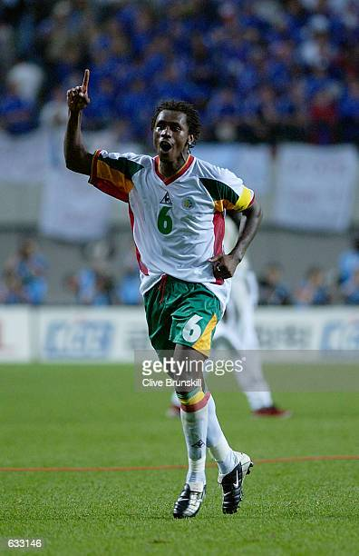 Captain Aliou Cisse of Senegal celebrates the 10 victory over France during the second half of the France v Senegal Group A World Cup Group Stage...