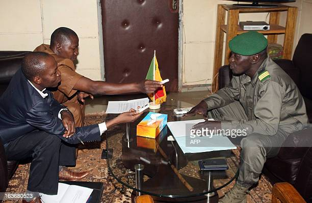 Captain Amadou Haya Sanogo who emerged from obscurity to lead a coup in March 2012 answers questions during an interview by the director of the 'Le...