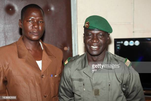 Captain Amadou Haya Sanogo who emerged from obscurity to lead a coup in March 2012 poses with answers the director of the 'Le Republicain' Malian...