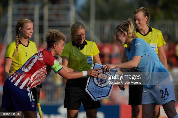 Captain Amanda Sampedro of Atletico de Madrid exchanges pennants with captain Keira Walsh of Manchester City during the UEFA Women Champions League...