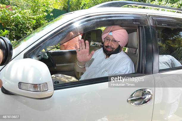 Captain Amarinder Singh candidate from Amritsar waves to the party leaders and supporters a day after polling on May 1 2014 in Amritsar India...