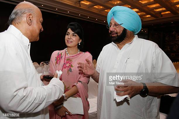 Captain Amarinder Singh with his Pakistani friend Aroosa Alam and Aditya Katoch of Kangra at the launch of a book of royal photographs dating back to...