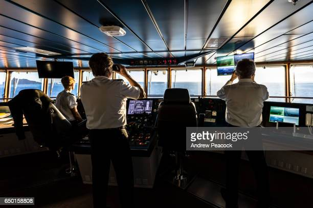 captain and officers on the bridge of a ship. - team captain stock pictures, royalty-free photos & images