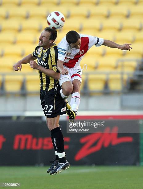 Captain Andrew Durante of the Phoenix jumps for the ball in the air with Adrian Zahra of the Heart during the round 15 ALeague match between the...
