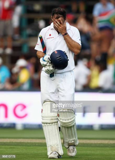 Captain Andrew Strauss of England holds his head as he walks off after losing his wicket to Wayne Parnell of South Africa for lbw and 22 runs during...