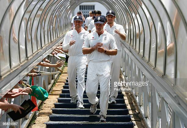 Captain Andrew Strauss of England leads his teammates down the tunnel from the players balcony following England's defeat to South Africa during day...