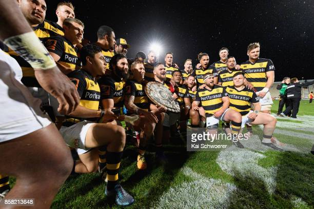 Captain Angus Ta'avao of Taranaki and his team mates pose with the Ranfurly Shield after the win in the round eight Mitre 10 Cup match between...