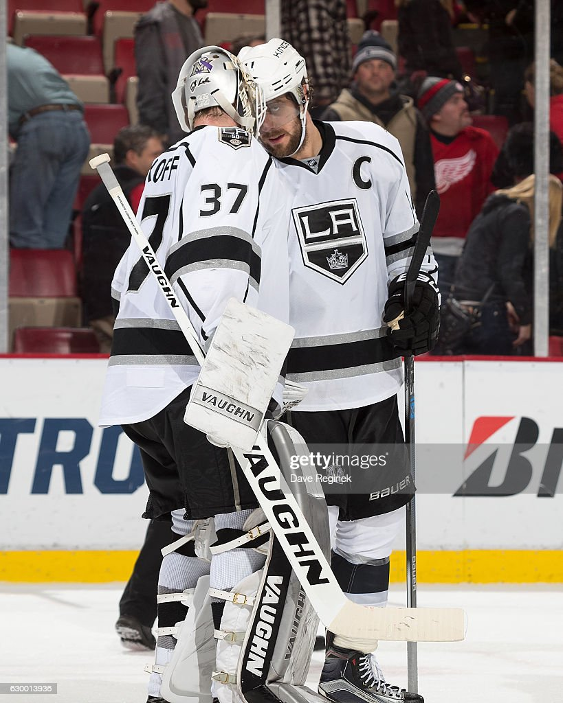 Captain Anze Kopitar #11 of the Los Angeles Kings congratulates teammate Jeff Zatkoff #37 on his win after an NHL game against the Detroit Red Wings at Joe Louis Arena on December 15, 2016 in Detroit, Michigan. The Kings defeated the Wings 4-1.