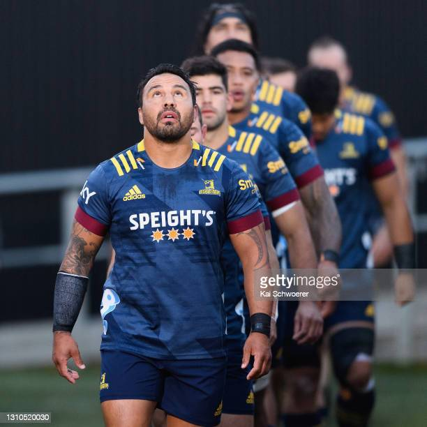 Captain Ash Dixon of the Highlanders leads his team onto the field prior to the round 6 Super Rugby Aotearoa match between the Crusaders and...