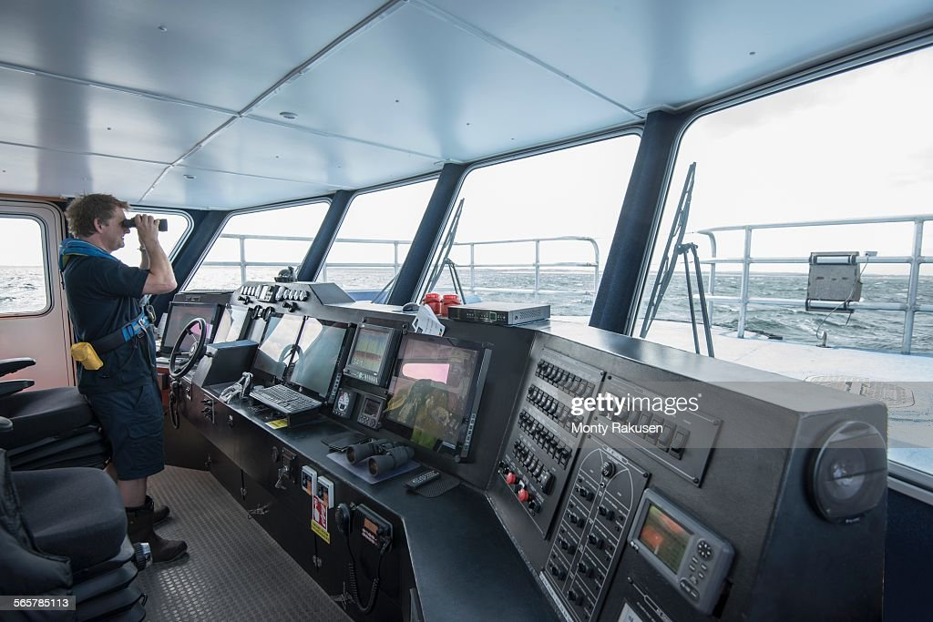 Captain at the bridge of marine research ship : Stock Photo