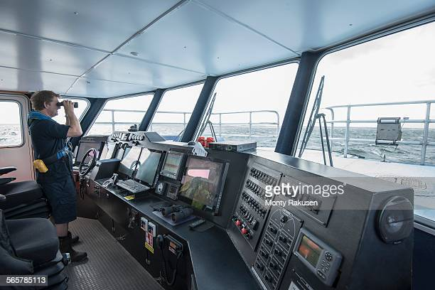 Captain at the bridge of marine research ship
