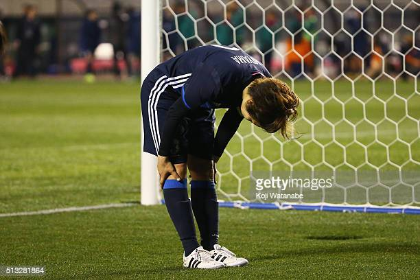Captain Aya Miyama of Japan bows to applaud supporters after her team's 11 draw in the AFC Women's Olympic Final Qualification Round match between...