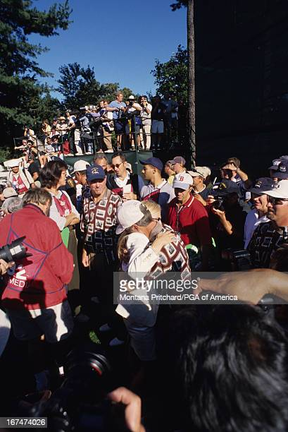Captain Ben and Julie Crenshaw in the crowd of media during the 33rd Ryder Cup Matches held at The Country Club in Brookline Massachusetts Sunday...