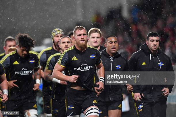 Captain Brad Shields of the Hurricanes and his team mates look on prior to the round 15 Super Rugby match between the Crusaders and the Hurricanes at...