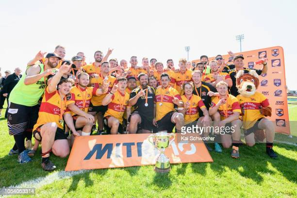 Captain Brett Ranga of Thames Valley and his team mates pose with the Meads Cup after their win in the Heartland Championship Meads Cup Final match...