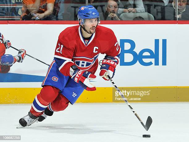 Captain Brian Gionta of the Montreal Canadiens skates with the puck during the NHL game against the Ottawa Senators on November 6 2010 at the Bell...