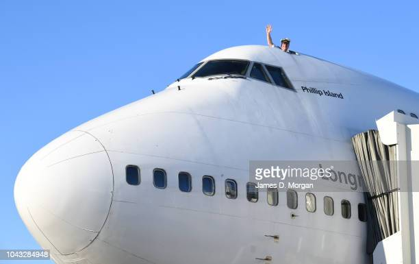 Captain Brian Meade waves from the cockpit escape hatch on arrival with Qantas flight number 4 from Honolulu a Boeing 747400 aircraft at Sydney...