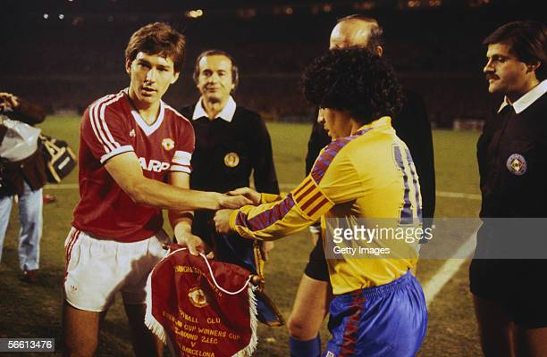 Captain Bryan Robson of Manchester United shakes hands with Barcelona captain Diego Maradona before the European Cup Winners Cup QuarterFinal Second...