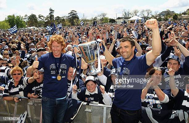 Captain Cameron Ling and coach Chris Scott pose with the Premiership Cup during Geelong Cats AFL Grand Final celebrations at Kardinia Park on October...