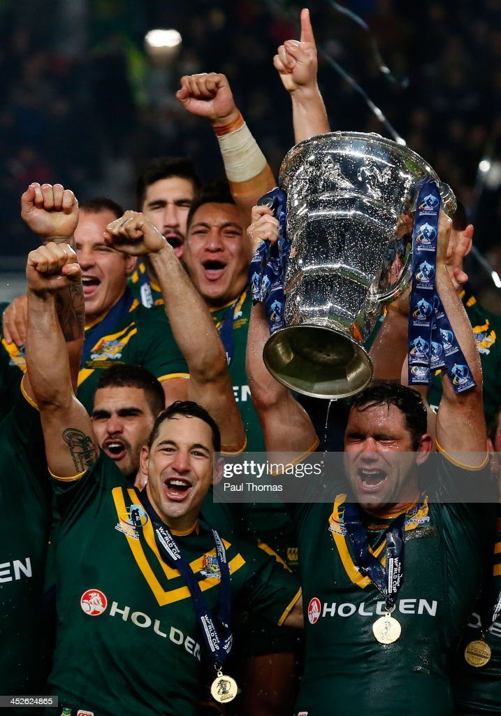 Captain Cameron Smith (R) and Billy Slater (L) of Australia celebrate with the trophy after the Rugby League World Cup final between New Zealand and Australia at Old Trafford on November 30, 2013 in Manchester, England.