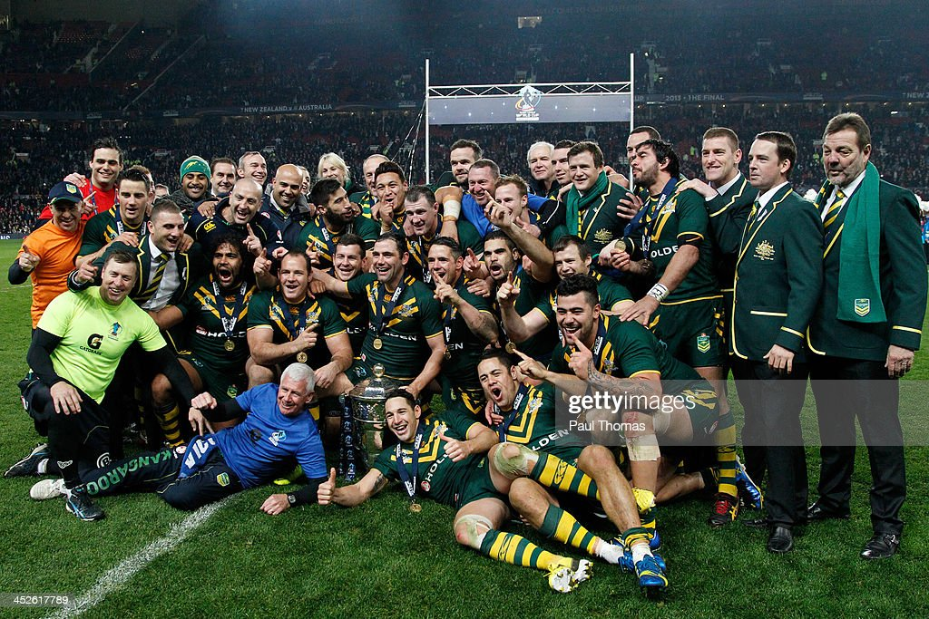 Captain Cameron Smith (C) of Australia celebrates with team mates and the trophy after the Rugby League World Cup final between New Zealand and Australia at Old Trafford on November 30, 2013 in Manchester, England.