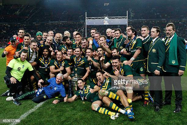 Captain Cameron Smith of Australia celebrates with team mates and the trophy after the Rugby League World Cup final between New Zealand and Australia...