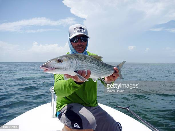 Captain Carl Ball holds up a nice bonefish caught in Biscayne Bay With bonefish scarce in Florida Bay plenty of flats guides are making the long boat...