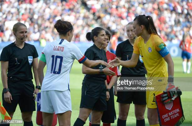 Captain Carli Lloyd exchanges pennants with the captain of Chile Cristiane Endler before the 2019 FIFA Women's World Cup France group F match between...