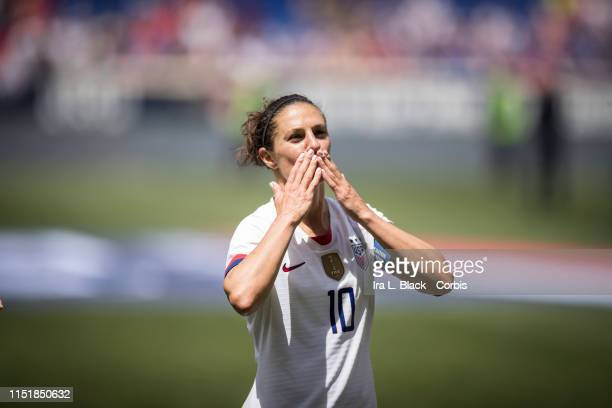 Captain Carli Lloyd of United States blows a kiss to fans during the send off after the International Friendly match the US Women's National Team and...