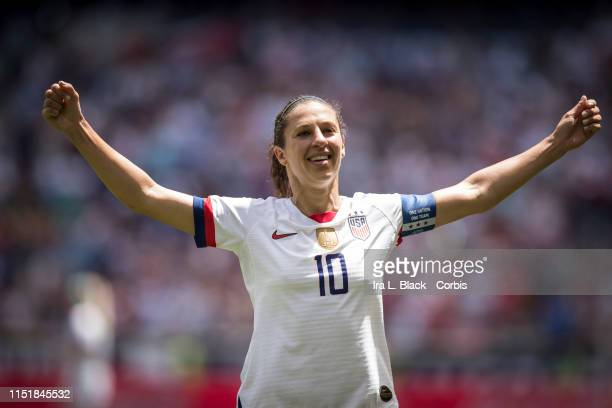 Captain Carli Lloyd of United States holds up his arms to celebrate scoring goal in the 2nd half of the during the International Friendly match the...