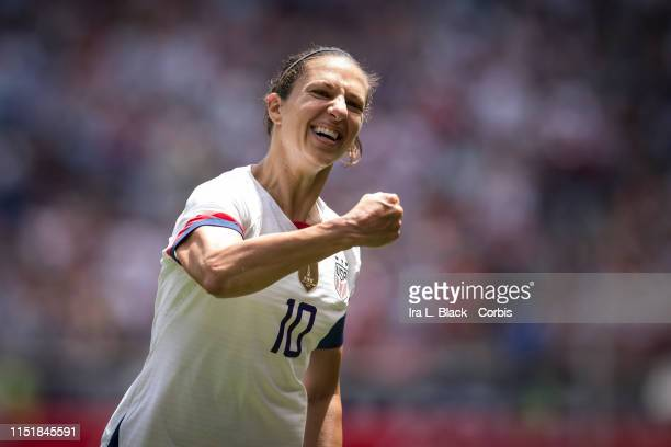 Captain Carli Lloyd of United States throws up her arms to celebrate scoring goal during the International Friendly match the US Women's National...