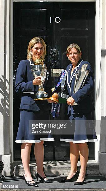 Captain Charlotte Edwards and Nicola Shaw of The England Women's Cricket Team pose for a photograph at Downing Street on July 14 2009 in London...