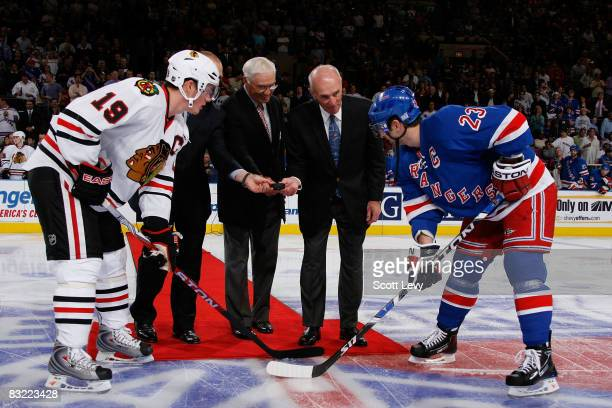 Captain Chris Drury of the New York Rangers and Captain Jonathan Toews of the Chicago Blackhawks are joined by former Rangers Adam Graves Andy...