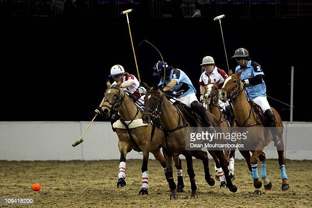 Captain Chris Hyde of EFG Bank Team England and Oscar Mancini of Camino Real Team Argentina battle for the ball during the The First International...