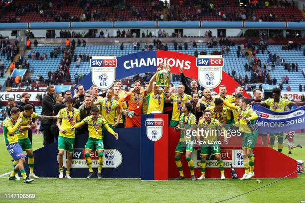 Captain Christoph Zimmermann of Norwich City lifts the championship trophy in celebration with team mates after the Sky Bet Championship match...