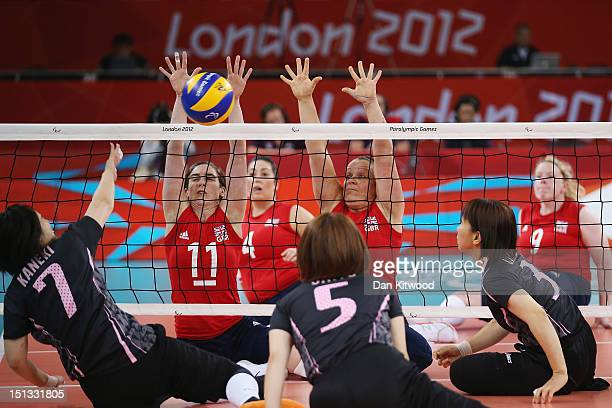 Captain Claire Harvey of Great Britain reaches up to block a shot during the Women's Sitting Volleyball 78 Clasification match against Japan on day 8...