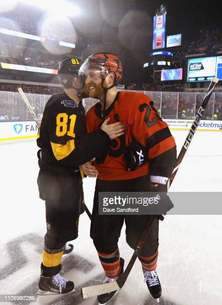 Captain Claude Giroux of the Philadelphia Flyers and Phil Kessel of the Pittsburgh Penguins shake hands after the 2019 Coors Light NHL Stadium Series...